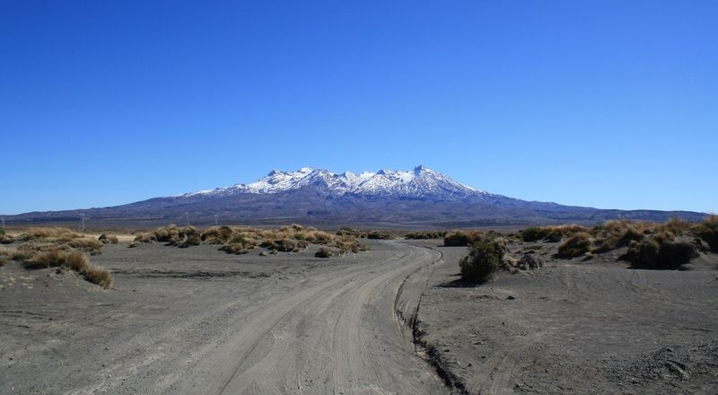 Beauty In Nature Blue Clear Sky Day Desert Landscape Mountain Nature New Zealand New Zealand Landscape New Zealand Scenery No People Outdoors Road Scenics Sky Snow The Way Forward Tire Track Tongariro Tongarironationalpark