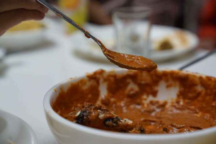 Indian Restaurant Close-up Eating Utensil Finger Focus On Foreground Food Food And Drink Freshness Hand Holding Human Body Part Human Hand Indian Food Indian Recipe Indoors  Indulgence Kitchen Utensil One Person Plate Ready-to-eat Real People Spoon Sweet Food Temptation Unrecognizable Person