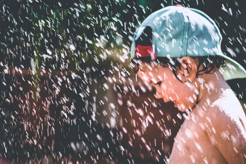 Shirtless Cute Boy Enjoying Rain