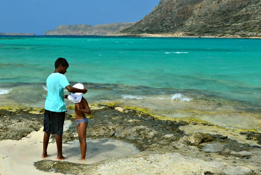 A nice moment at Balos beach Beach Brothers Childhood Live For The Story Elementary Age Emotions Family Full Length Innocence Lifestyles Mountain Nature Outdoors People Person Sand Sea Shore Standing Summer Togetherness Tranquil Scene Vacations Water People And Places