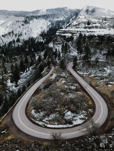 The Crest PNW Winding Road Transportation Curve High Angle View Snow Nature EyeEmNewHere Mountain Road Beauty In Nature Landscape Cold Temperature Winter Outdoors Sky Tree Day EyeEmNewHere