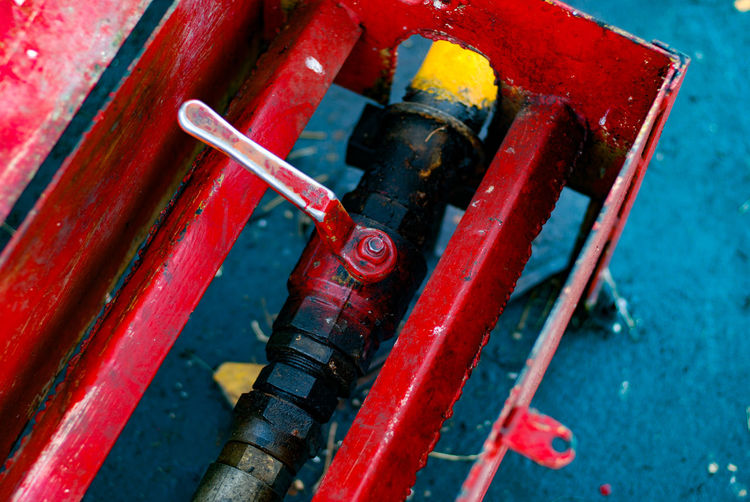 Red No People Close-up Metal Industry Focus On Foreground Equipment Connection Pipe - Tube Machinery Machine Valve Group Of Objects High Angle View Technology Water Indoors  Day Control Small Group Of Objects
