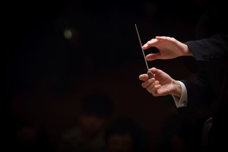 Conductor conducting an orchestra Photography In Motion Conductor Conducting Motion Capture The Moment Capturing Movement Hands Baton Concert Music Stick Orchestra Concert  Leader People OpenEdit Professional Classical Holding Dark Market Bestsellers 2017
