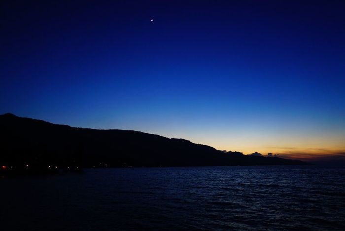 Blue Beauty In Nature Nature Tranquility Tranquil Scene Clear Sky Scenics Silhouette No People Sea Outdoors Water Night Mountain Moon Sunset Sky Tourism Travel Destinations Travel LakeToba  INDONESIA Sumatra
