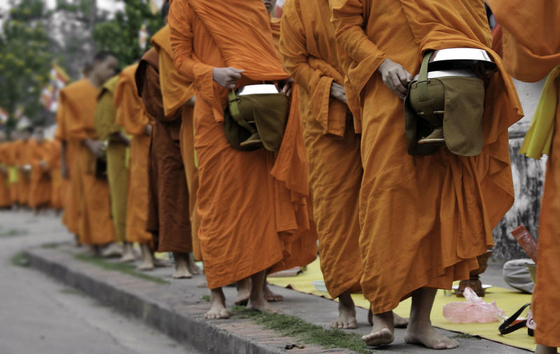 monks walking for alms in lao Buddha LAO LINE Alms Giving Clothing Footpath Group Group Of People In A Row Men Monks Walk Orange Robes Outdoors People Real People Religion Robe Traditional Clothing Walking
