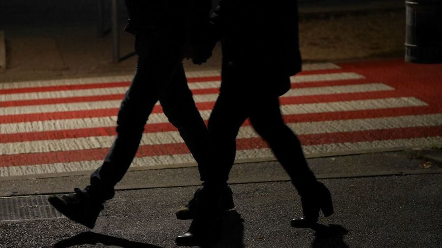 Low Section Real People One Person Shadow Human Leg Body Part Human Body Part Walking Street Lifestyles Men Red City Night Road Marking Capture Tomorrow