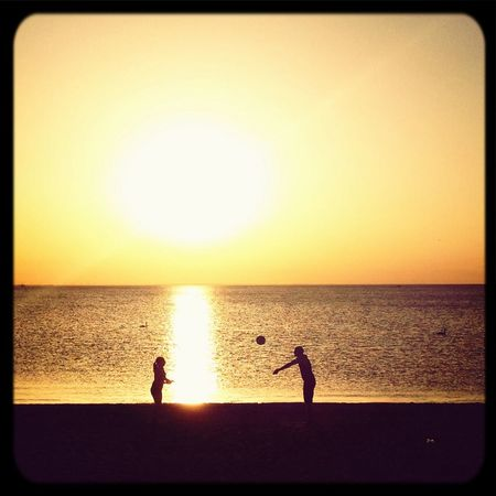 Volleyball at the Beach . Sunset Silhouettes