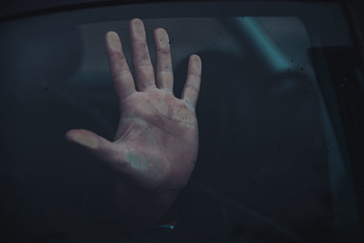 Close-up of woman hand on mirror