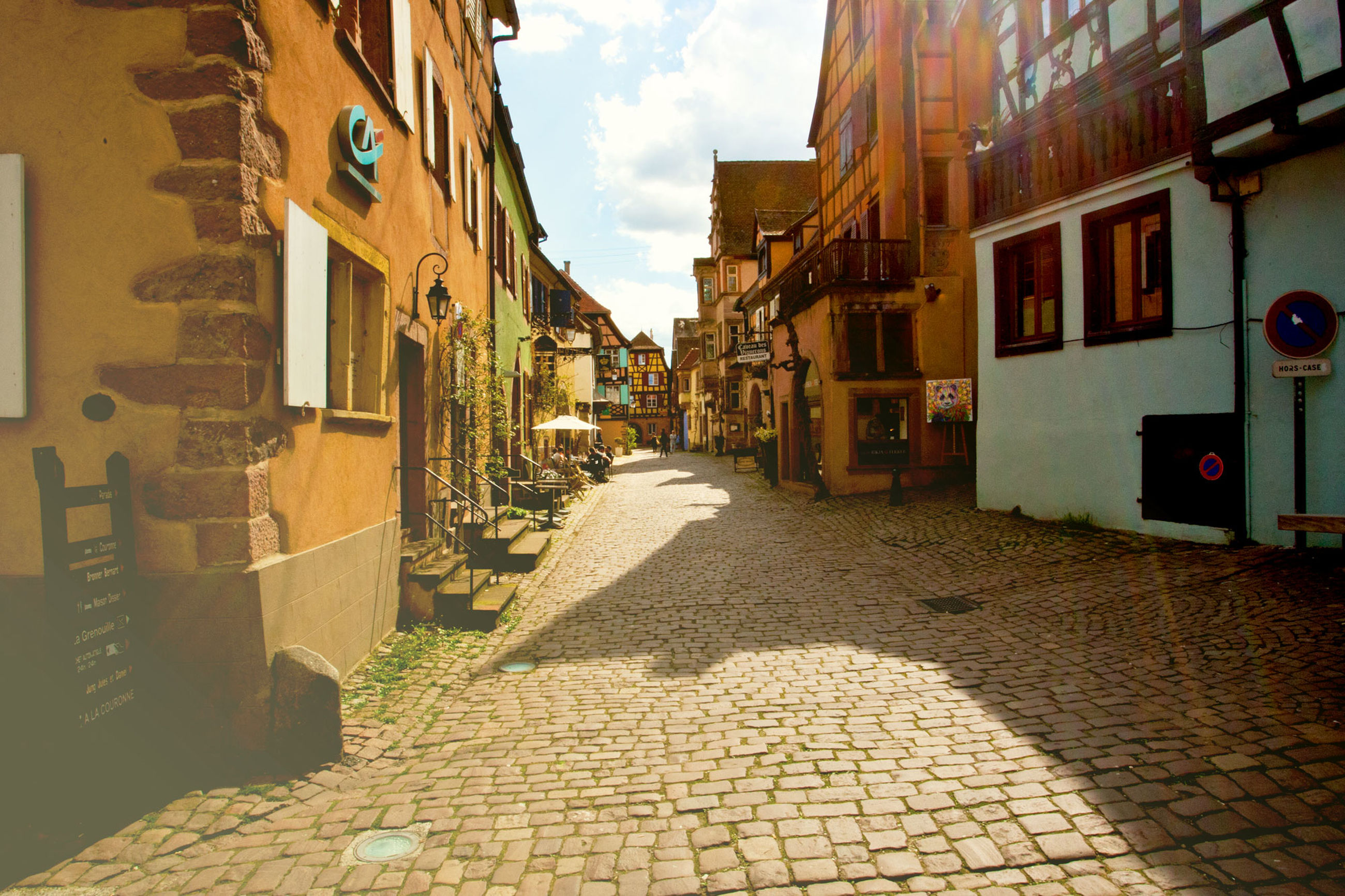 building exterior, city, street, architecture, built structure, cobblestone, building, residential district, the way forward, direction, footpath, nature, sky, cloud - sky, town, outdoors, transportation, no people, day, house, alley, paving stone, long