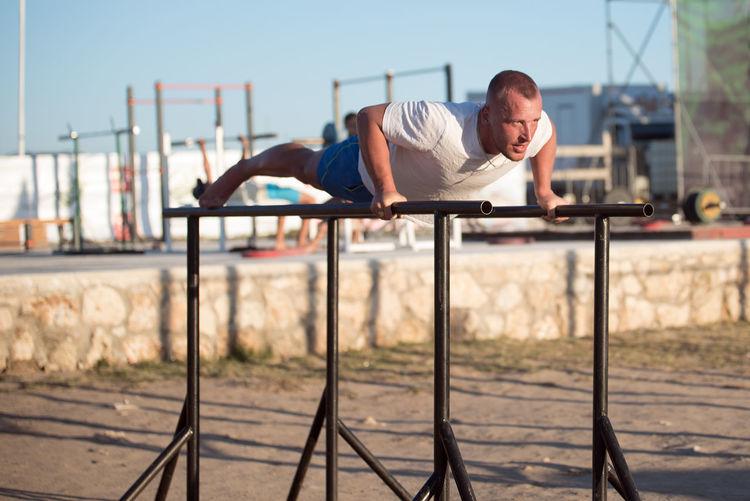 Man exercising at park