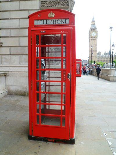 One of the most famous shots in London Red Telephone Box Historical Building Historical Place Travel Footpath Red Pavement Big Ben Telephone Box Communication Telephone Incidental People Outdoors International Landmark Capital Cities  Travel Destinations London Tourism Sidewalk Built Structure Building Exterior Day Connection Tall - High British Culture