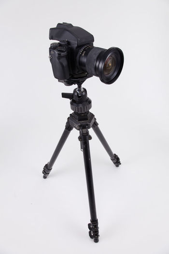 studio shot of high end digital camera on the tripod Camera Photography Multimedia Expertise Professional Occupation Tripod Photograph DSLR Lens Equipment Photographic Theme Photographing Black Nobody White Background Medium Format Camera Photography Themes Technology Studio Shot Camera - Photographic Equipment Indoors  No People Still Life Photographic Equipment Close-up Digital Camera Copy Space Single Object High End Medium Format Black Color Communication Industry Cut Out