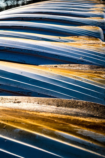 boats overturned on the shore Boats Overturned On The Shore Transportation No People Road Speed Yellow Day Abstract Motor Vehicle Connection Backgrounds Motion Outdoors Nature Mode Of Transportation Pattern Car Metal Highway Full Frame High Angle View
