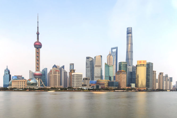 Shanghai, China: March 26, 2016: Day view of the Bund, the most scenic spot in Shanghai with the most famous Chinese skyscrapers Architecture Building Exterior Built Structure Bull Bund Capital Cities  China City Cityscape Famous Place Landmark Metro Modern Office Building People Shnaghai Skyscraper Subway Tall - High Tourists Tower Travel Destinations Urban Skyline Water Waterfront