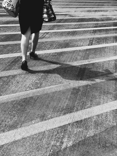 Bareng bayangan Walking Low Section One Person Real People Rear View Human Leg Outdoors Lifestyles Day Women Adult People Adults Only The Street Photographer - 2017 EyeEm Awards Blackandwhite Blackandwhite Photography Black And White Let's Go. Together. Black And White Friday Colour Your Horizn