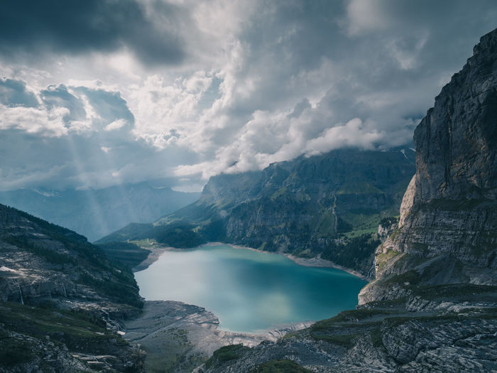 Oeschinensee Kandersteg Beauty In Nature Scenics - Nature Mountain Cloud - Sky Water Tranquil Scene Sky Rock No People Tranquility Nature Non-urban Scene Mountain Range Solid Rock - Object Day Land Rock Formation Outdoors Formation Eroded
