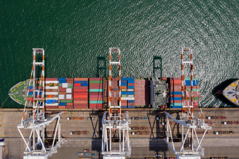 Container ship terminal, and quay crane of container ship at industrial port with shipping container