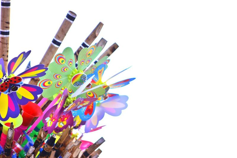 Colorful flutes against white background