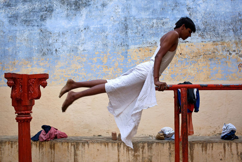 Exercises in an outdoor gym in Varanasi, India. India Varanasi Travel Gym Fitness Exercising Exercising Balance Adults Only Vitality Skill  Adult Full Length Outdoors