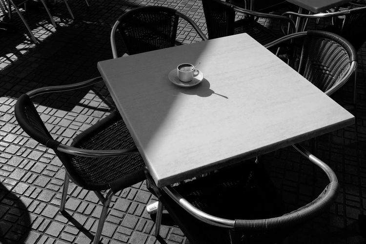 High angle view of empty coffee cup on table at cafe