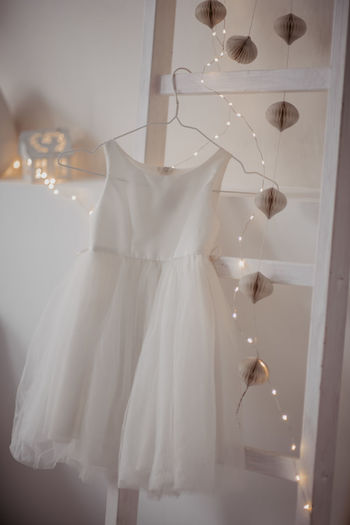 Clothes hanging on white curtain at home