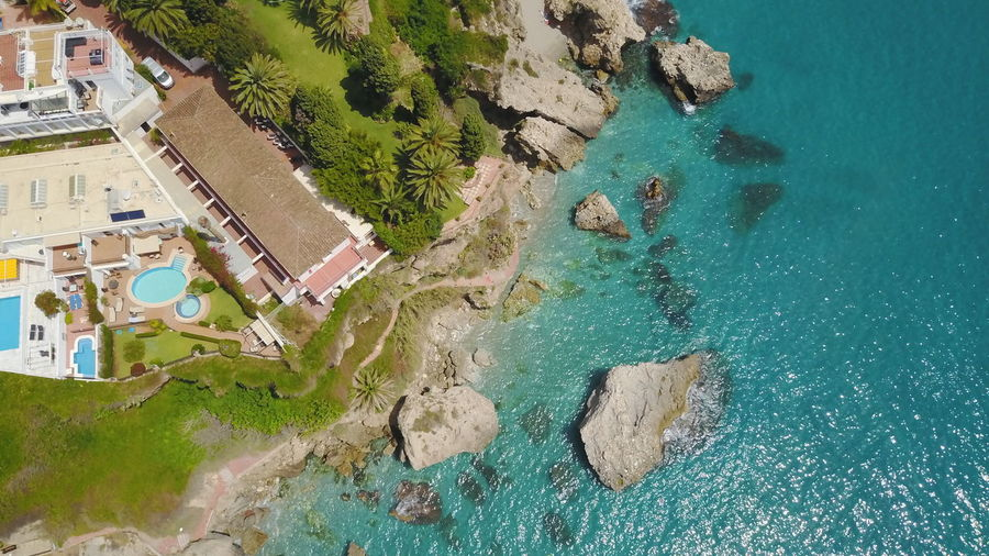 High Angle View Of Sea By Resort At Beach