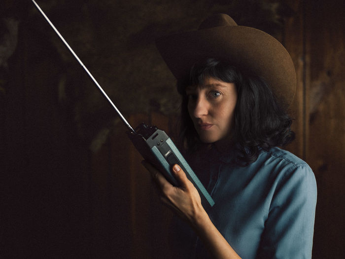 Portrait of young woman using walkie-talkie