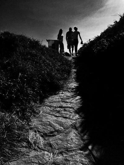 Full length of friends standing on landscape
