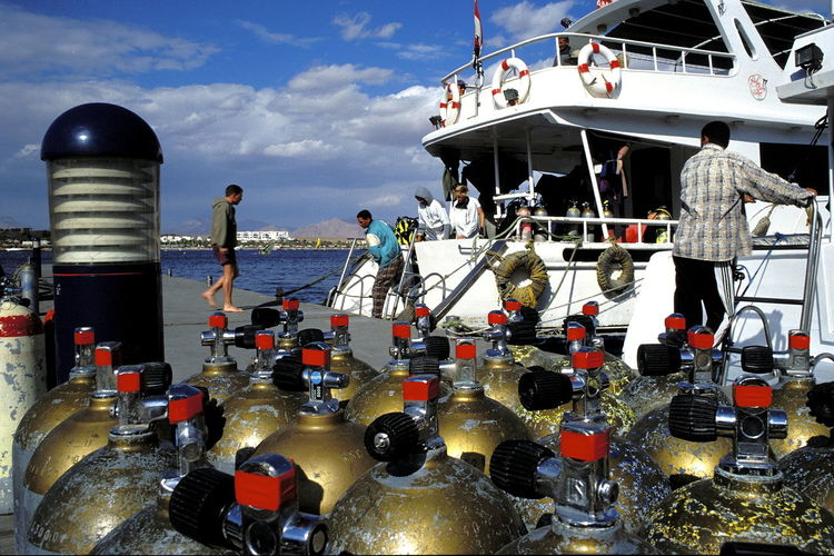 Adult Adults Only Boat Boat Deck Day Divers Diving Bottles Diving Cylinders Diving Tanks Harbour Outdoors People Pier Port Red Sea Sea Sharm El-Sheikh Sky Water Wharf