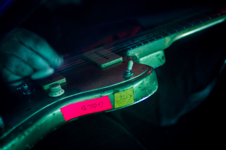 Close-up of hand on guitar
