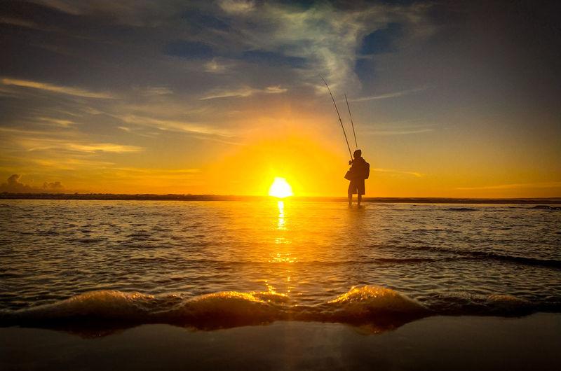 Fisherman and beach