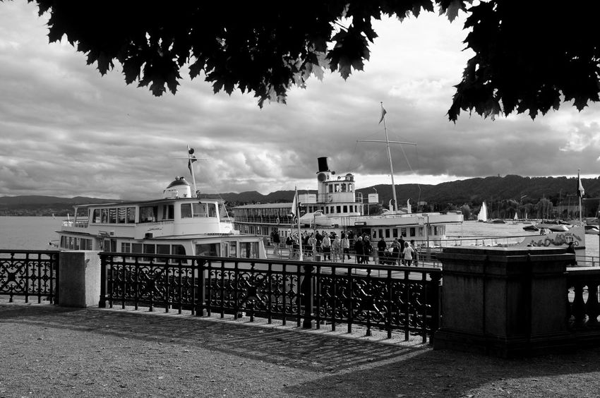 Black & White Nature Transportation Beauty In Nature Black And White Cloud - Sky Darkness And Light Fujifilm_xseries Harbor High Contrast Incidental People Lake Lake View Lake Zürich Mode Of Transport Monochrome Moored Nautical Vessel Outdoors Paddlesteamer Red Filter Steamboat Travel Destinations Water Waterfront