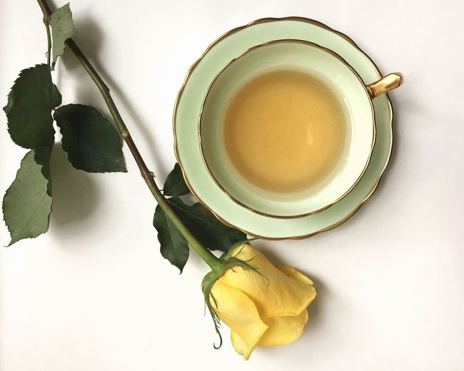 Delicate Bone China Teacups TeaCup Tea Yellow Yellow Rose Rose🌹 Rose - Flower Still Life Food And Drink High Angle View Freshness White Background Directly Above Table No People Refreshment Indoors  Drink Flower Close-up Day
