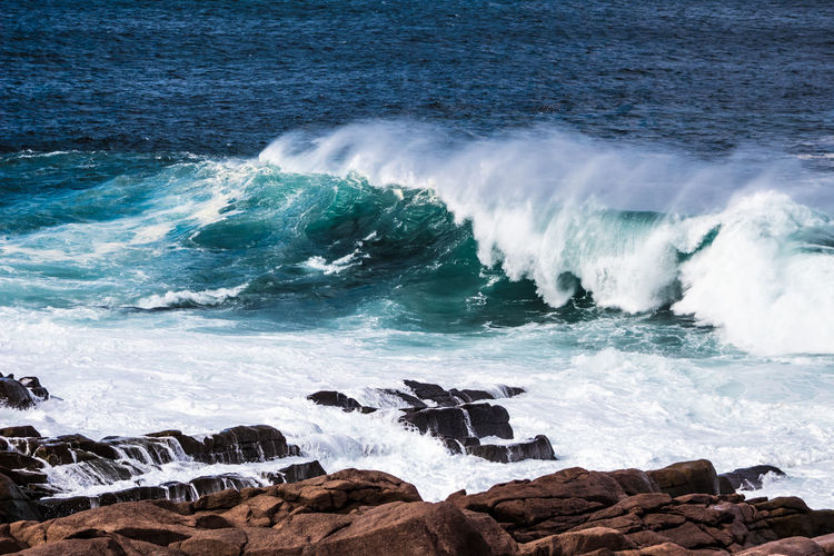 SURF Aquatic Sport Beach Beauty In Nature Beauty In Nature Breaking Day Flowing Water Hitting Land Motion Nature Outdoors Power Power In Nature Rock Rock - Object Scenics - Nature Sea Solid Splashing Sport Surfing Water Wave