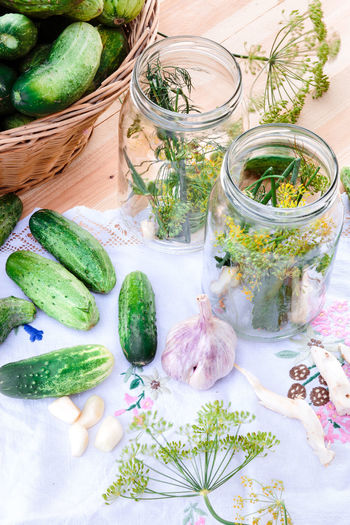 Pickling cucumbers with home garden vegetables and herbs Cucumber Day Dill Food Fresh Freshness Garden Garlic Healthy Eating Herb Homemade Ingredient Jar Natural No People Organic Outdoors Pickle Preparation  Preparing Preservation Preserve Rustic Traditional Vegetable