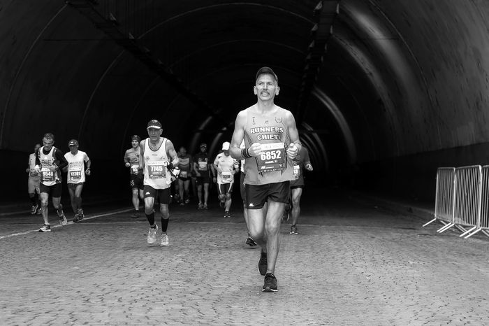Rome, Italy - April 2nd, 2017: Athletes of the 23rd Rome Marathon to the passage of the tunnel Umberto I, a few kilometers from the finish. Blackandwhite Casual Clothing Day Front View Full Length Leisure Activity Lifestyles Looking At Camera Man Running Outdoors Real People Romemarathon Runner Sport Event Sport Race Walking