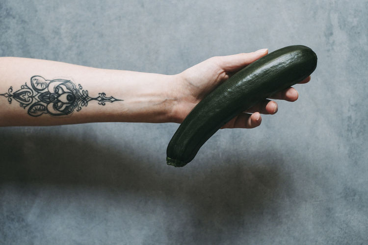 Berlin Cucumber Food Styling Food And Drink Green Vegetables & Fruits Woman Food Food Stories Healthy Healthy Eating Holding Human Body Part Human Hand Indoors  Ink Lifestyles One Person Tattoo Vegetable