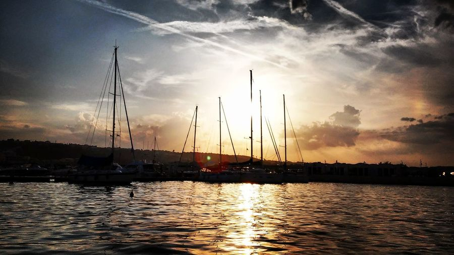 Sunset Water Beauty In Nature Nature Nautical Vessel No People Outdoors Sky Mast Silhouette Sea Cloud - Sky Sailboat Yacht Day Harbour Vieste Puglia Sea View Shadows & Lights Sunset_collection Sunset And Clouds  Sunshine And Summer Time Summer Summer Views Boats And Water