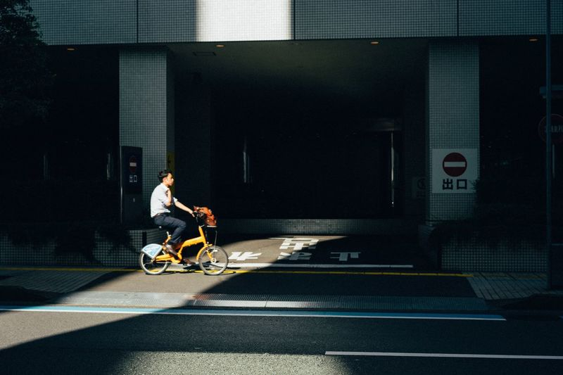 Days. Transportation City Full Length Mode Of Transportation Street One Person Road Architecture Real People Motion Riding Ride Men Side View Sunlight Shadow Sign Outdoors