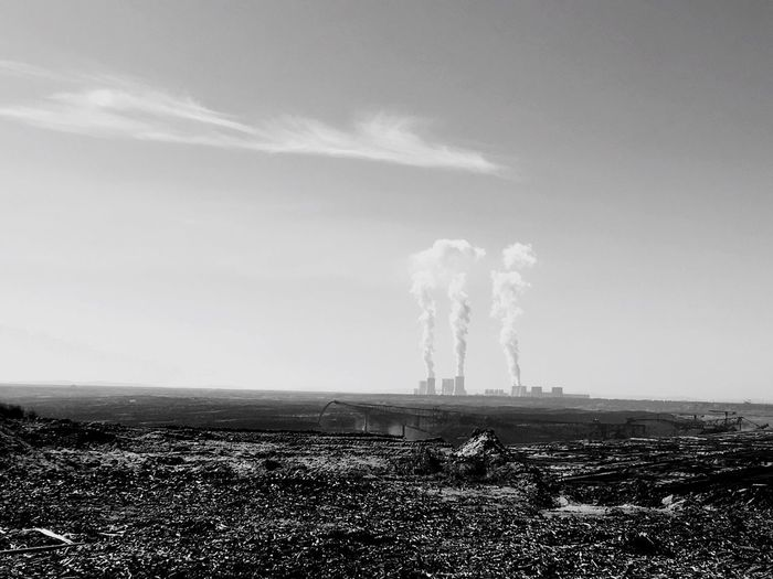 Sky Outdoors Landscape Smoke - Physical Structure Air Pollution Factory Nature Emitting Day Field No People Beauty In Nature - Opencast Mining