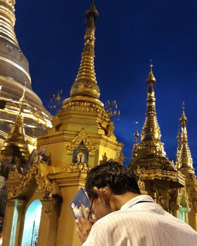 Buddhist praying Religion Pagoda Gold Colored Architecture Gold Spirituality Travel Destinations Human Body Part Place Of Worship People Sky One Person Outdoors Day Adults Only Adult Ancient Myanmar Shwedagon Pagoda Pray Praying Buddha Buddhism Buddhist Temple