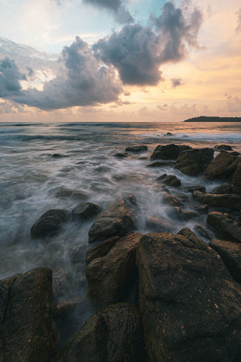Sky Sea Water Rock Beauty In Nature Scenics - Nature Cloud - Sky Sunset Solid Rock - Object Horizon Over Water Motion Land Horizon Beach No People Nature Tranquility Idyllic Outdoors Rocky Coastline Breaking