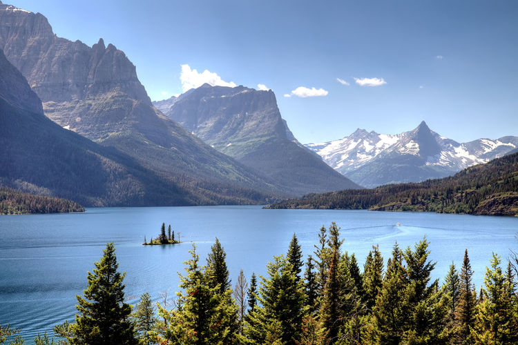 Scenic view of st mary lake against rocky mountains during winter