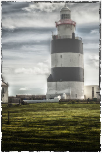Architecture Building Exterior Built Structure Cloud Cloud - Sky Cloudy Day Field Grass Hook Head, Ireland Hook Lighthouse Ireland Ireland🍀 Landscape Lighthouse Nature Outdoors Protection Sky Tower Tranquil Scene Wexford