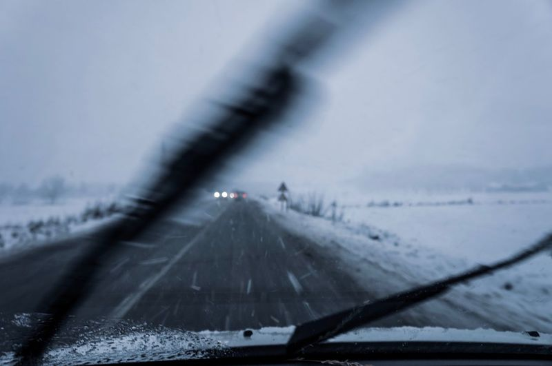 Snowing Windshield Wiper Snow Storm Driving Danger Road Safety Snowing Cold Temperature Transportation Mode Of Transportation Snow Winter Car Nature Windshield Land Vehicle Motor Vehicle Glass - Material No People Vehicle Interior Road Travel Transparent Water Outdoors