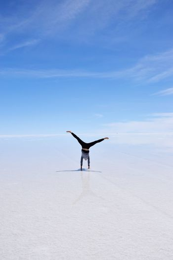 Salt flats Bolivia Uyuni Breathless View Hikingadventures Travel One Person Sky Lifestyles Land Leisure Activity Nature Water Real People Sea Day Beauty In Nature Full Length Non-urban Scene Tranquility Arms Outstretched Tranquil Scene Scenics - Nature Outdoors