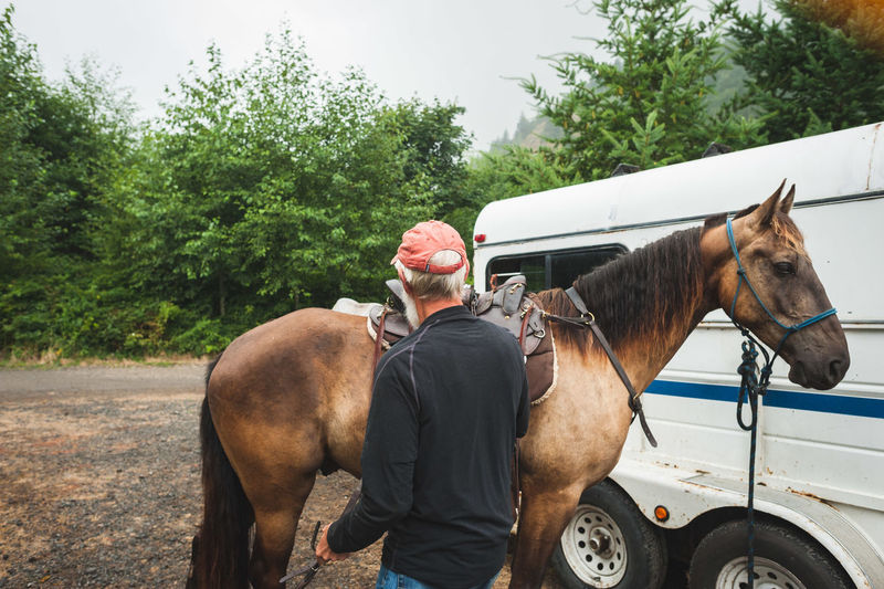 Adult Adventure Camping Domestic Animals Equestrian Farm Horse Horse Riding Horses Lifestyles Livestock Man Mobile Home Nature Outdoors Pacific Northwest  PNW Retirement Rural Scene Rustic Transportation Wilderness Winter Woman