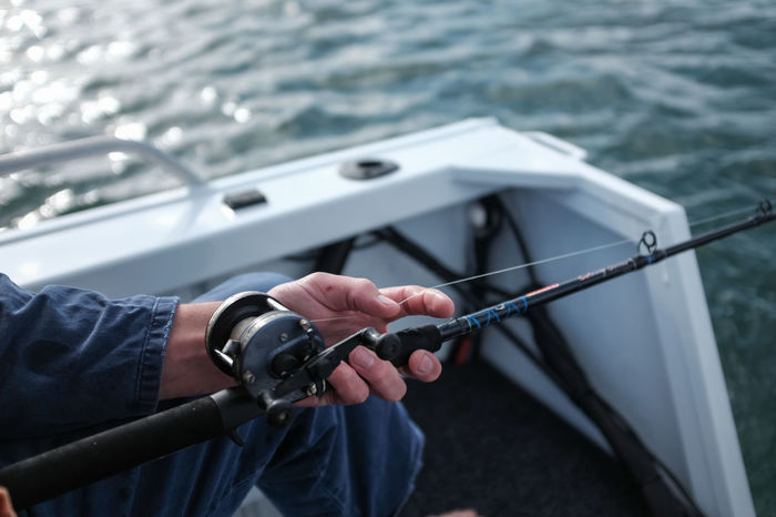 Close up of hand and fishing rod on boat Australia Australian Close Up Close-up Day Fishing Holding Human Body Part Human Hand Men Mode Of Transport Nature Nautical Vessel One Person Outdoors People Real People Rod Sailing Sea Transportation Water Yachting
