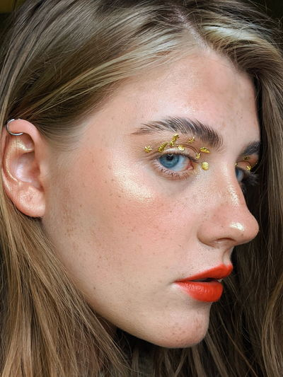 Close-up portrait of woman with make-up on face