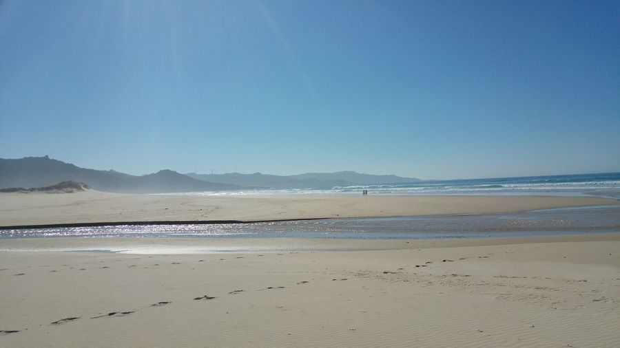 Beach Sand Sea Water Beauty In Nature Nature Landscape Mountain Blue Scenics Outdoors Travel Destinations Tranquility Sky Vacations Wave Swimming Flamingo Desert Horizon Over Water Galicia, Spain